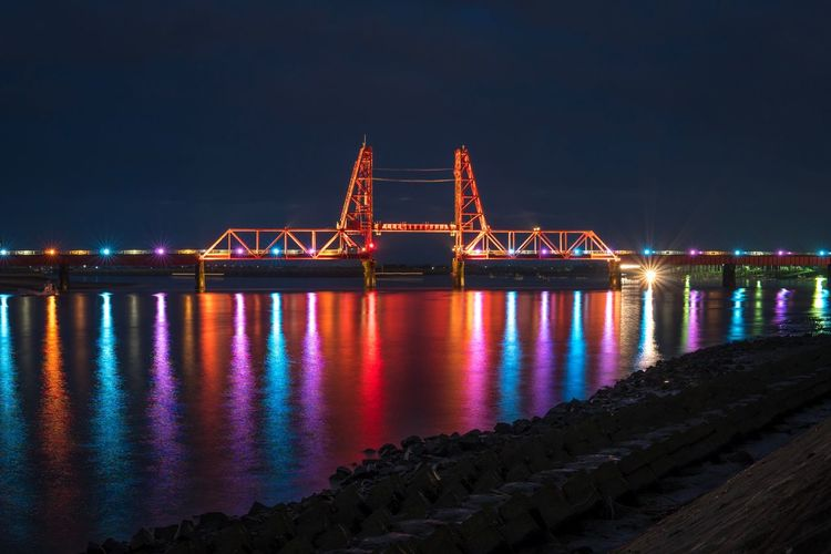Night Connection Bridge - Man Made Structure Illuminated Architecture Built Structure Engineering Travel Destinations Suspension Bridge Waterfront No People Water Building Exterior Chain Bridge Travel Reflection Outdoors Transportation River Sky