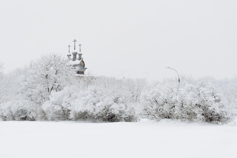 Snow Winter Cold Temperature Plant Building Exterior Architecture White Color Nature Built Structure Tree Building Land No People Day Tower Covering Field Beauty In Nature Tranquility Outdoors Snowing Church Woden