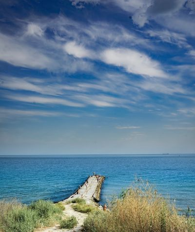 Horizon Over Water Sea Sky Water Nature Scenics Cloud - Sky Tranquil Scene Tranquility Day Beauty In Nature Outdoors No People Beach Grass Blue