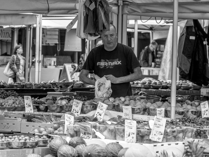 Man having food in market