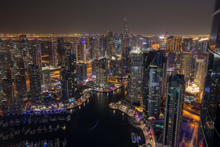 Beautiful view of the Dubai Marina at night Architecture City Building Exterior Built Structure Illuminated Cityscape Skyscraper Office Building Exterior Building Tall - High Night Water Modern Tower Crowd Sky Urban Skyline Office Financial District  Light Boats Aerial View Dubai Marina UAE