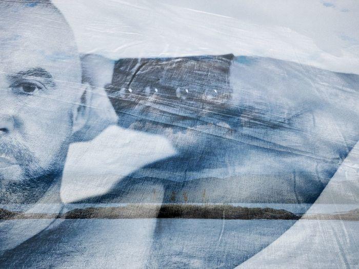 Digital composite image of man with umbrella