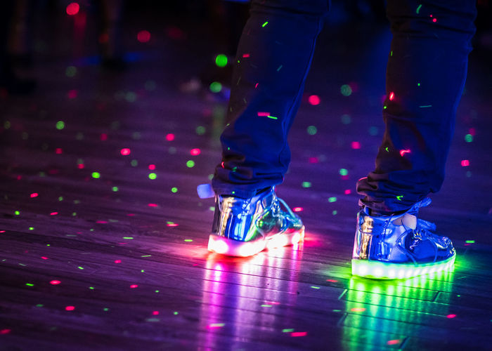 Flashing multi-coloured techno shoes dancing in a nightclub. Night Clubbing Techno Close-up Dance Floor Disco Lights Human Leg Illuminated Indoors  Led Shoes Lifestyles Low Section Multi Colored Night Night Club Nightclub Nightclub Photography Nightclubbing Nightlife One Person Real People Shoes Technology