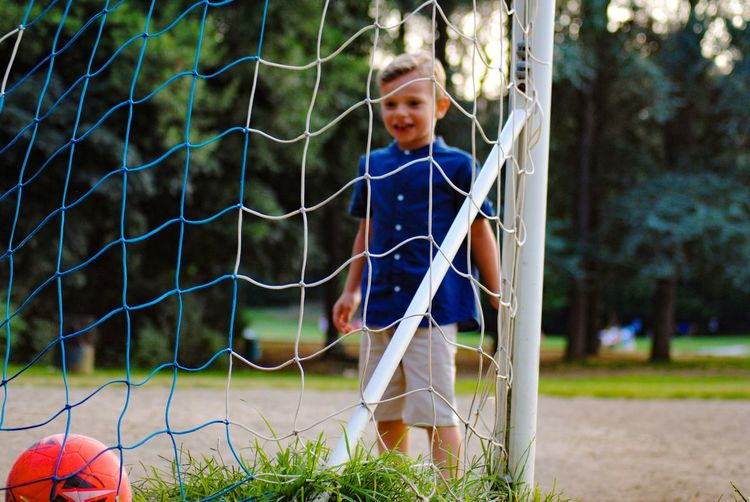 Boy playing soccer at field