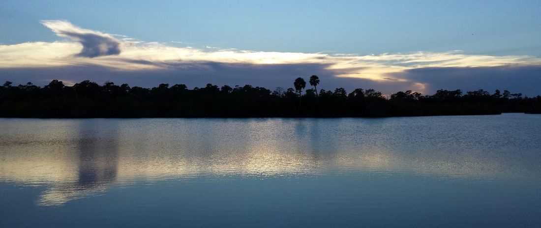 Sunset Pareidolia On The St Sebastian River Faces In The Clouds Sebastian, Fl Water Reflections Clouds And Sky