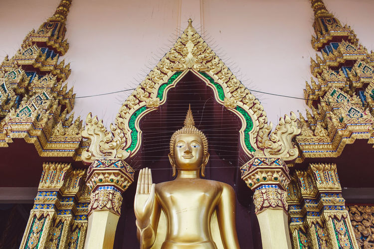 Belief Religion Spirituality Representation Place Of Worship Art And Craft Built Structure Architecture Statue Sculpture Low Angle View Building No People Human Representation Gold Colored Male Likeness Creativity Idol Ornate Spire