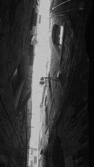Low angle view of a dark narrow alley of old times Artistic Dark Low Angle View Narrow Panorama Venice Streets Blackandwhite Dark Alley Distortion Grain No People Old Times Outdoors Street