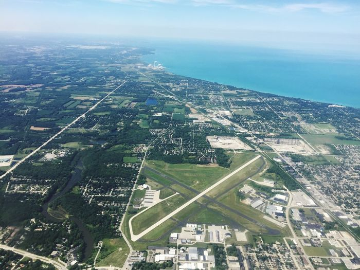 Racine, Wisconsin and Lake Michigan Flying Aerial Shot From An Airplane Window