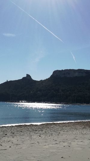 Poetto beach Sardinia Sardegna Italy  Today :) Sun Light Winter Beach Sand Mountain Sea Landscape Beauty In Nature Outdoors Nature No People Scenics Water Day Vapor Trail Sky Blue Tranquility Tranquil Scene Mountain Range Clear Sky