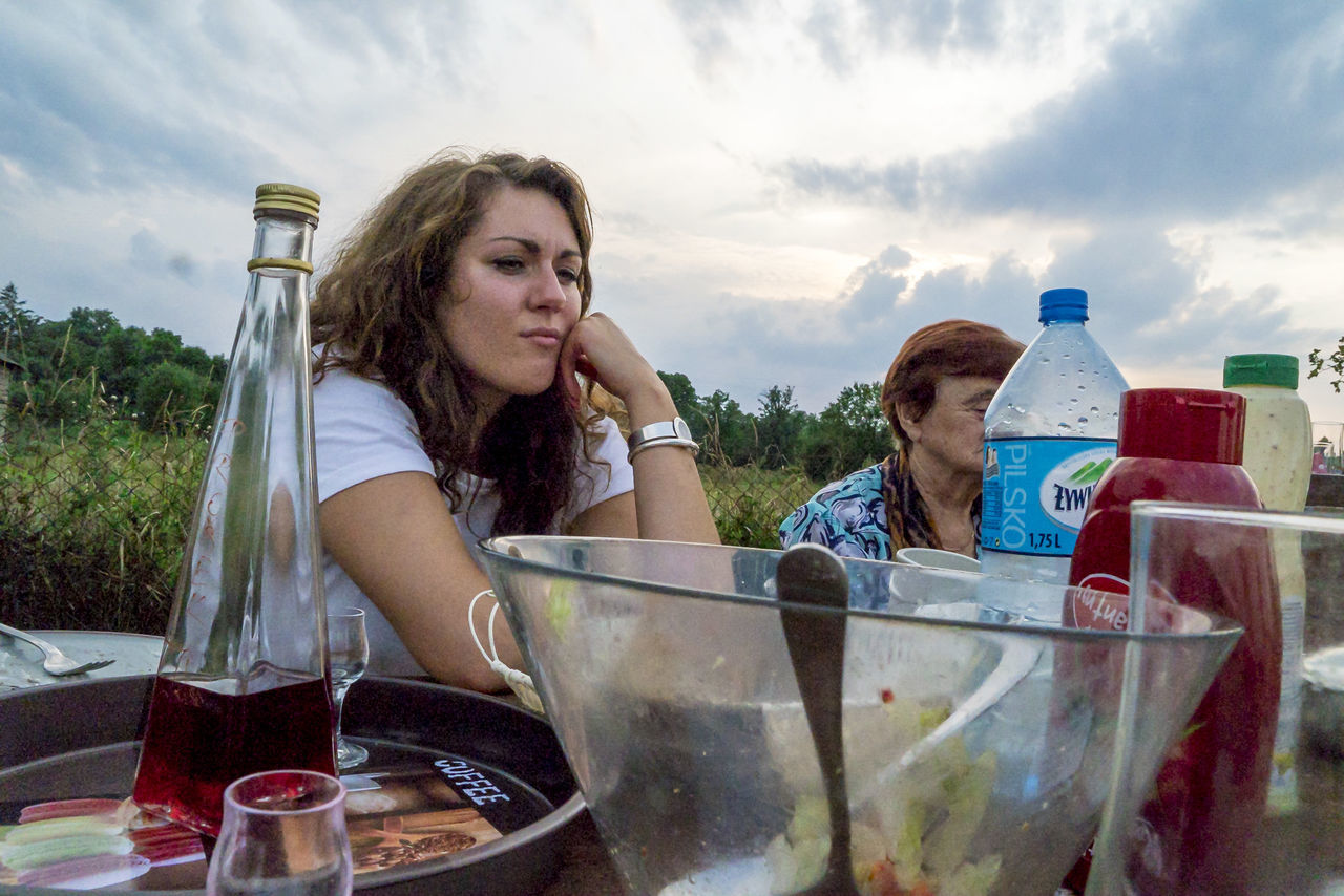 bottle, sky, food and drink, cloud - sky, young adult, young women, outdoors, drink, drinking, togetherness, real people, food, two people, day, sitting, water, people