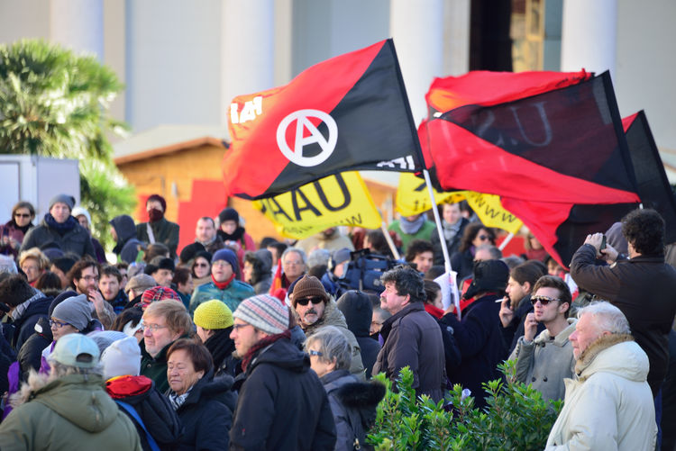 LGBT HUMAN RIGHTS demonstration against Putin who was present in Trieste Anarchist Anarchist Flag Arcigay Arcilesbica Crowd Demonstration Demonstration Against Putin Large Group Of People LGBT Rights People Piazza Sant'antonio Protest Putin S.o.s. Russia Street Streetphotography