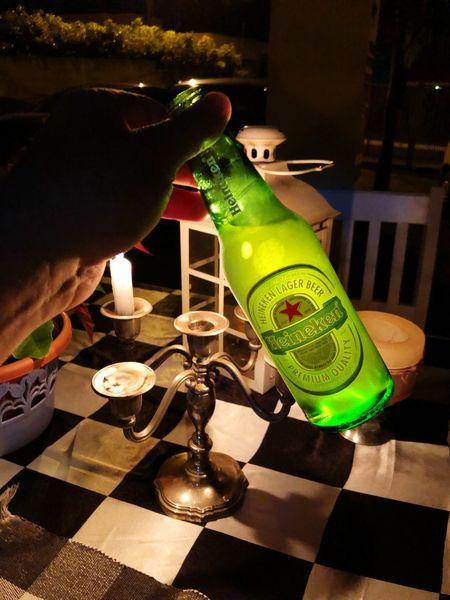 Heineken Beer Heineken Real People One Person Human Hand Indoors  Human Body Part Holding Leisure Activity