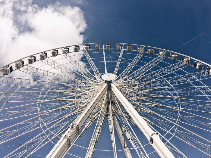 EyeEm Selects Amusement Park Arts Culture And Entertainment Ferris Wheel Low Angle View Amusement Park Ride Sky Blue No People Big Wheel Day Outdoors