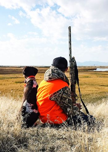 Pheasant Hunting + Mans Best Friend = Happiness! Gsp Germanshorthairpointer Hunting Sky Rural Scene Cloud - Sky Outdoors Men Domestic Animals Mammal Nature Beauty In Nature One Person Day Adult People