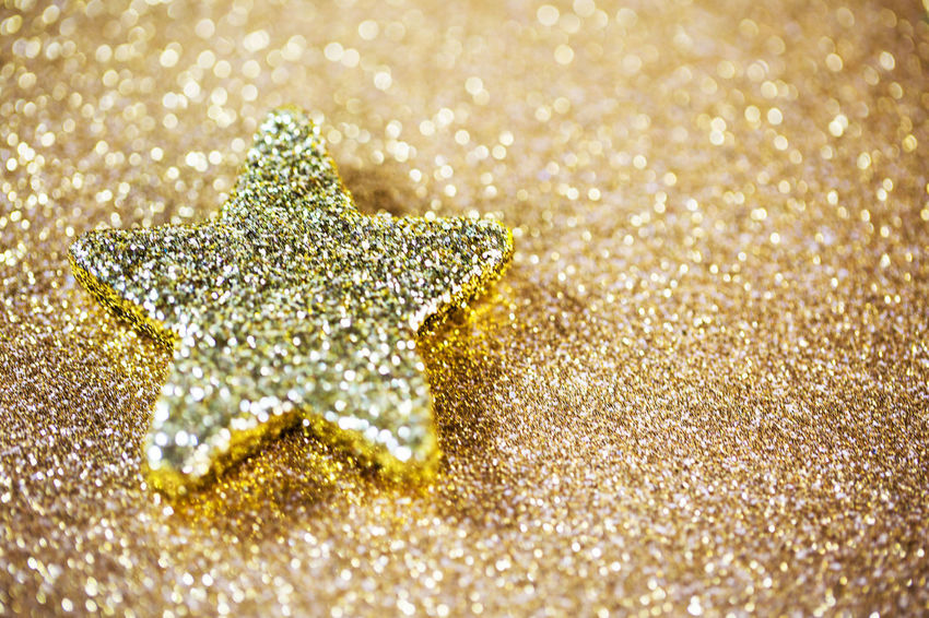 Beach Bright Celebration Christmas Christmas Decoration Christmas Ornament Close-up Copy Space Decoration Glitter Gold Colored Holiday Indoors  Nature No People Sand Selective Focus Shape Shiny Snow Star Shape Starfish  Studio Shot