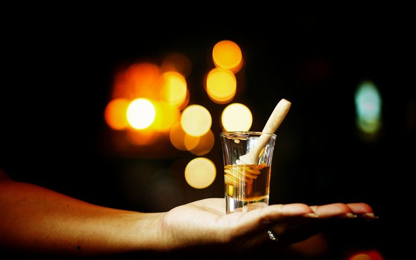 hand on bokeh Human Hand Illuminated Holding Drink Close-up Cigarette Lighter Candlelight Oil Lamp Burning Candlestick Holder Fire - Natural Phenomenon Flame Igniting Tea Light Bonfire Darkroom Fire Pit Candle Lit Wax Diwali Fire