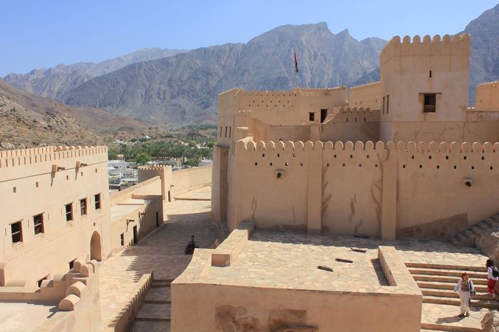 Nizwa Fort Castle in Oman Arabian Architecture Castle Nizwa Fort Oman Arab Arabic Architecture Day Desert Landscape Fortress Nizwa Oman_photo Oman_photography Sandstone