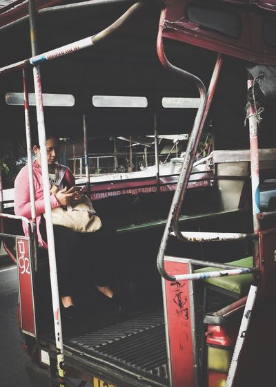 reality.. Bangkok Thailand. Traffic Jam Travel Transportation Redbus Alone Onthebus Ontheroad Looking At Mobile Siting Asianwoman Thaiwoman Woman Transportation Train - Vehicle Public Transportation Mode Of Transport Real People Railroad Station Platform Day