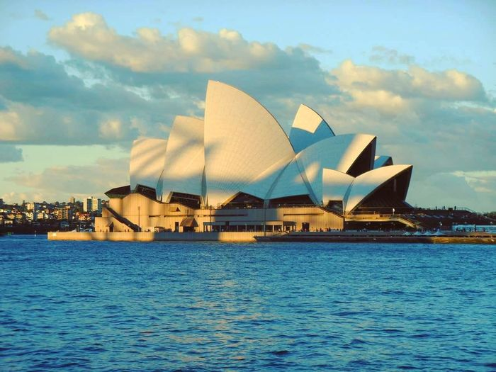 The alluring Sydney Opera House. Architecture Travel Destinations Travel Building Exterior Cityscape Modern Water City Sunset Sydney Opera HouseTravel Photography Scenics Traveling Travel Travelphotography Postcard Vacations Sydney, Australia Sydney Photography Sydneyharbour Sydneyoperahouse
