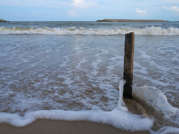 The wooden stick on the beach with strong wave. Sea And Sky Sea Sand Wave Waves, Ocean, Nature Damper Retention Standing Standpoint Nature Life Stable Water Strong Stronger Face Brave Dare Conquer Remain Purposeful World Wide Life Fearless Fearlessness