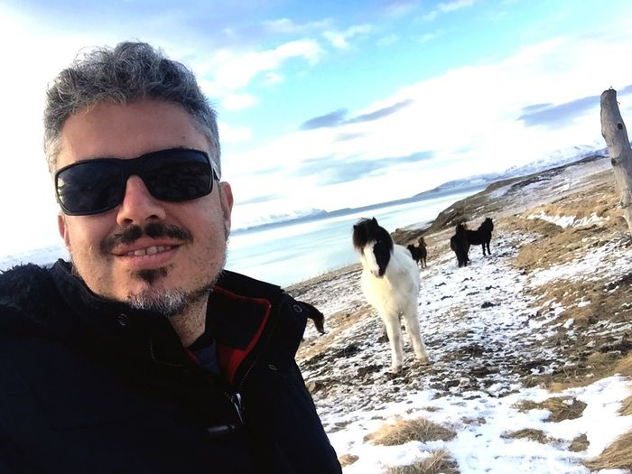 Domestic Animals Mammal Dog Real People Pets Lifestyles Leisure Activity Sky One Person One Animal Nature Day Field Winter Pet Owner Beauty In Nature Outdoors Men Snow Landscape