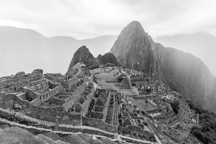 Panoramic view of historic building against mountain range