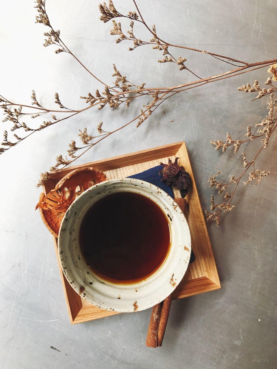 directly above, no people, coffee cup, high angle view, table, freshness, food and drink, indoors, drink, flower, close-up, tree, nature, day, branch, fragility