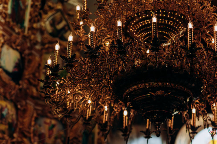 Low angle view of illuminated chandelier