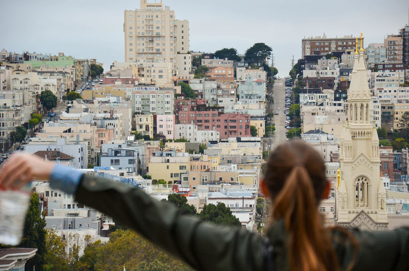 Embracing San Francisco Adventure Architecture Building Exterior City Cityscape Cloud - Sky Cloudy Colourful Curch Exploring Facing Away Fasade Hill Human Hand San Francisco Sky Streets Travel Urban Skyline Victorian Architecture Victorian House Walks Women Young Adult Young Women