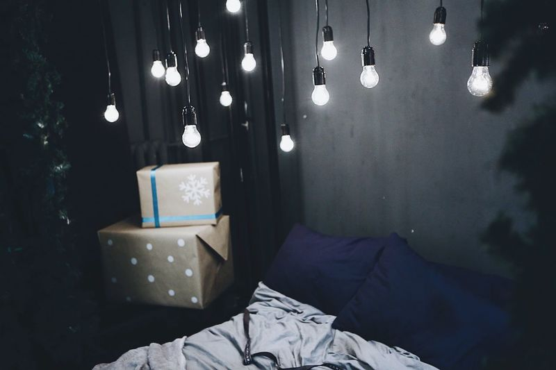 Bed Indoors  Real People One Person Bedroom Lifestyles Men Illuminated Close-up Day People VSCO Interior Design Christmas Lights Christmas Decoration Happy Atmosphere