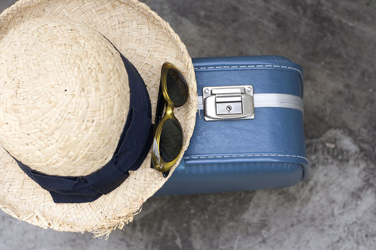 Holiday Let's Go. Together. Travel Adventure Blue Close-up Day Directly Above Focus On Foreground Hat Headwear High Angle View Ich Packe Meinen Koffer Into The Blue Leather Leaving Metal No People Single Object Still Life Straw Hat Suitcase Sunglasses Travel Items