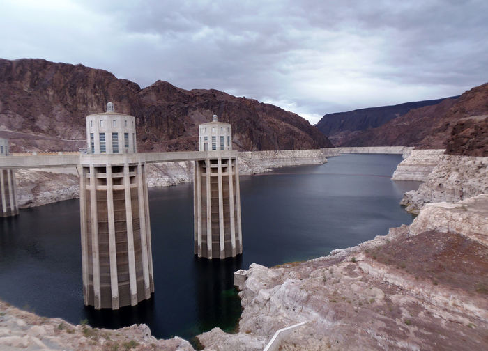 Scenic view of reservoir of hoover dam against cloudy sky