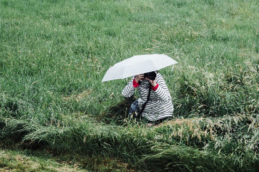 UNSUCCESSFUL STEALTH MODE Taking Photos Taking Pictures Adult Casual Clothing Day Field Grass Green Color Growth Land Leisure Activity Lifestyles Nature Outdoors People Phtographer Plant Protection Real People Security Stealth Mode Umbrella Women