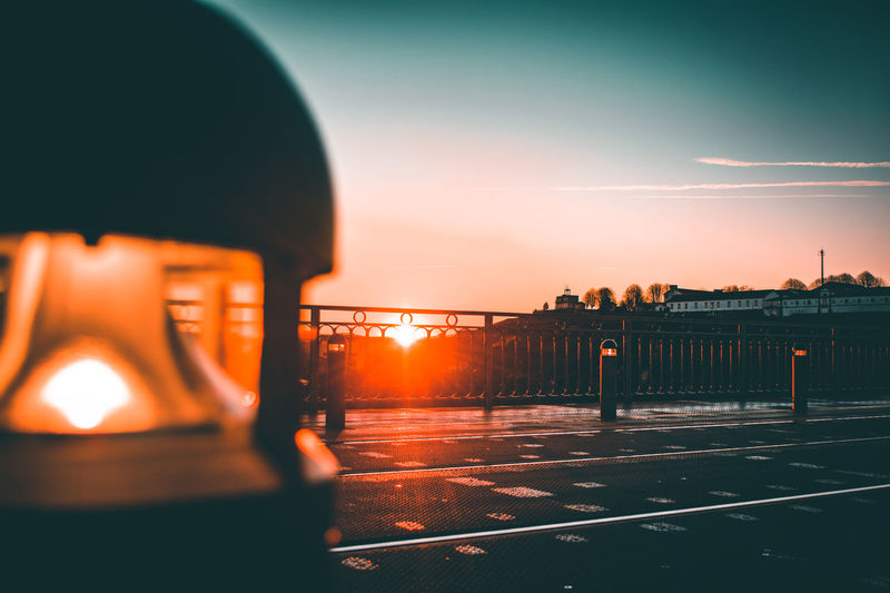 Architecture Barrier Building Exterior Built Structure City Close-up Cloud - Sky Focus On Background Helmet Mode Of Transportation Nature No People Orange Color Outdoors Protection Railing Security Sky Sunset Transportation