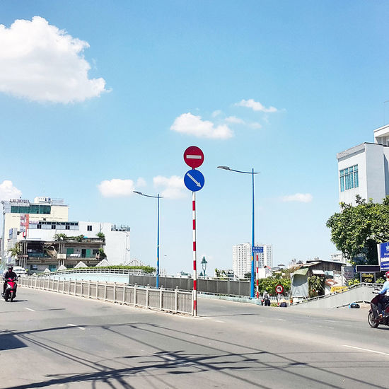 Architecture Building Exterior Built Structure City Cloud - Sky Day Ho Chi Minh City No People Noontime  Outdoors Red Light Road Road Sign Sky Transportation Travel Destinations