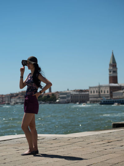 Young woman standing and enjoying the view of the Venice Venice, Italy Architecture Beautiful Woman Building Exterior Built Structure Camera - Photographic Equipment City Clear Sky Day Digital Single-lens Reflex Camera Full Length Leisure Activity Nature One Person Outdoors Photographing EyeEmPremiumShot Premium Collection Sea Young Women EyeEmNewHere The Week On EyeEm Eyeemtraveler✌