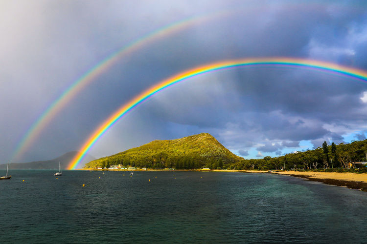Double rainbow over mountain and ocean Australia Australian Nature Port Stephens Beach Beauty In Nature Cloud - Sky Day Double Rainbow Idyllic Landscape Mountain Multi Colored Natural Arch Nature No People Outdoors Rainbow Scenics Shoal Bay Sky Tomaree Tranquil Scene Tranquility Water The Traveler - 2018 EyeEm Awards