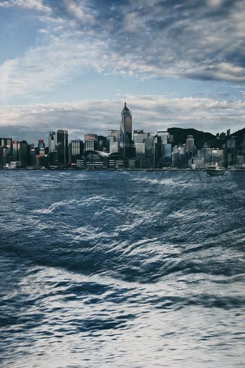 Hong Kong City Hong Kong Architecture Victoria Harbour Architecture Building Building Exterior Built Structure City Cityscape Cloud - Sky Motion Nature No People Office Building Exterior Outdoors Sea Sky Skyscraper Urban Skyline Water Waterfront Wave The Creative - 2018 EyeEm Awards