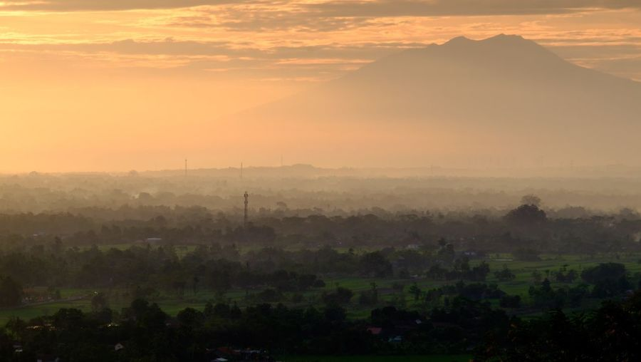 Jogjakarta Beauty In Nature Scenics - Nature Environment Landscape Tree Sky Plant Fog Nature Travel Destinations Mountain Tranquility No People Sunset Sun Architecture Morning Travel Outdoors Place Of Worship