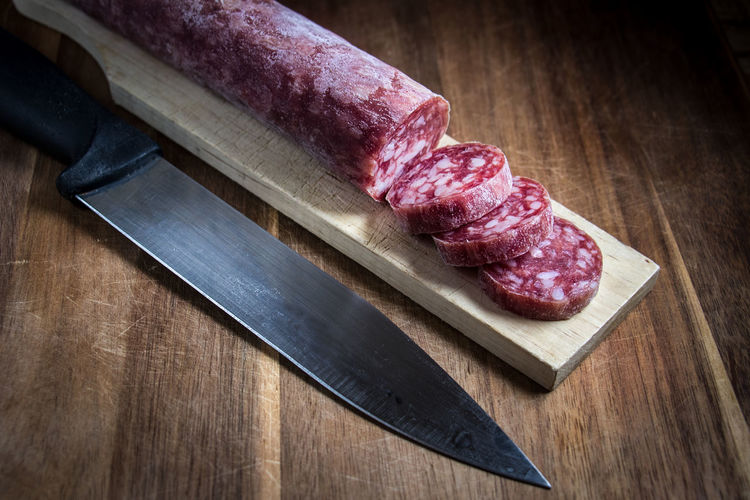 Beef Butcher Close-up Cutting Board Cutting Boards Day Food Food And Drink Freshness Indoors  Kitchen Knife Meat No People Pork Preparation  Raw Food Rib Salami SLICE Table Wood - Material