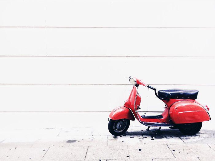 Red vintage car on road