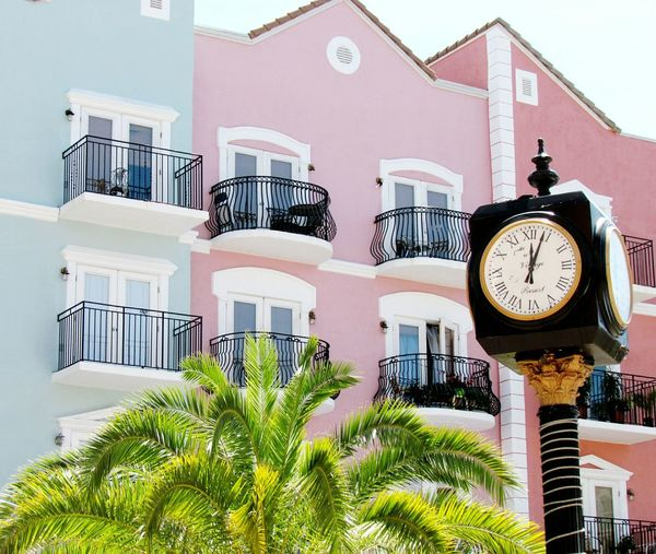 Building Exterior Clock Residential Building Built Structure Time Architecture No People Outdoors Low Angle View Day Clock Face City Minute Hand Window Millennial Pink Apartment Architecture High Angle View House