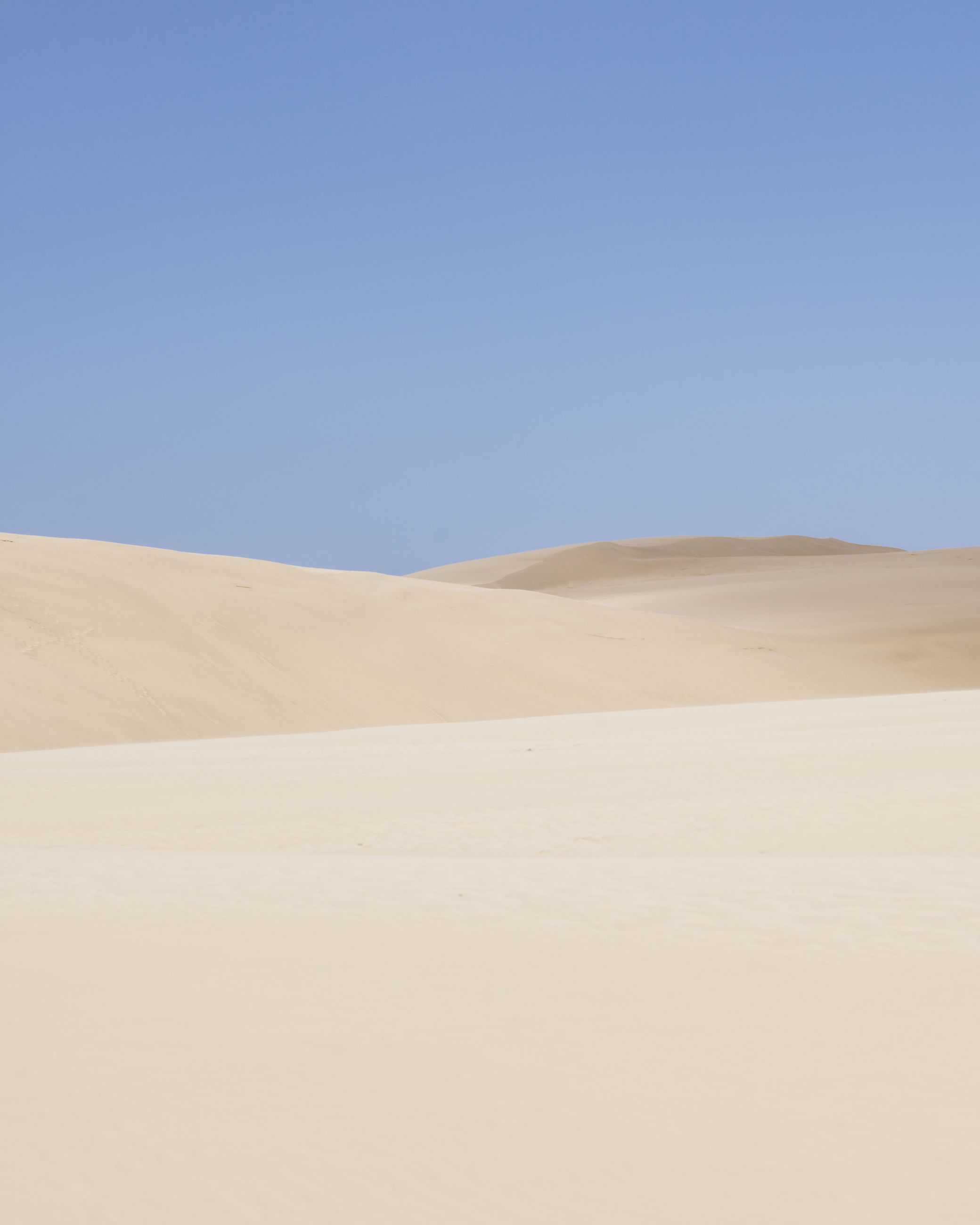 clear sky, copy space, blue, tranquility, tranquil scene, landscape, scenics, beauty in nature, nature, desert, remote, day, non-urban scene, outdoors, sand dune, horizon over land, no people, arid climate, idyllic, mountain