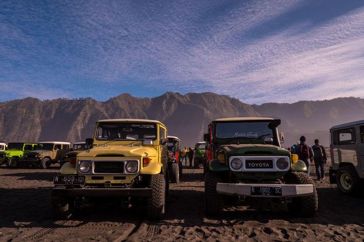 View of bus on desert against mountain range