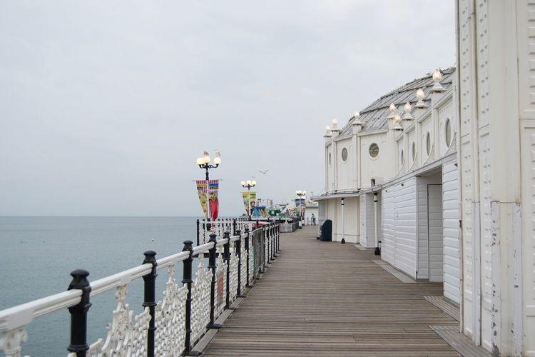 Brighton palace pier over sea against sky