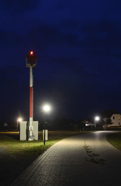 Hiddensee at night Baltic Sea Lantern Neuendorf Quiet Red Droppings Hiddensee Horse Droppings Illuminated Island Night No People Outdoors Sky Street Street Light Traffic Sign