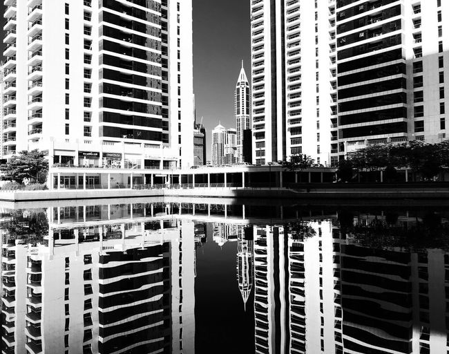 Black And White Friday IPhoneography Mobilephotography Architecture Building Exterior Built Structure Skyscraper City Reflection Modern No People Outdoors Day Cityscape Water Sky Adventures In The City