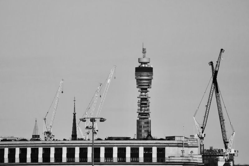 Post Office Tower, London, England. Post Office Tower London Uk Skyline Buildings Construction Crane - Construction Machinery Monochrome Blackandwhite Building Exterior Landmark City Cityscape Urban Skyline Skyscraper Business Finance And Industry Modern Industry Sky Architecture