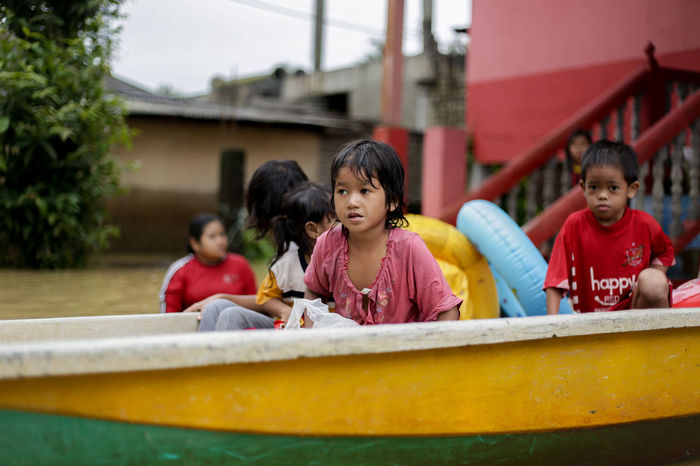 flood victims at kelantan Boys Childhood Day Elementary Age Enjoyment Flood Victims At Kelantan Friendship Fun Girls Happiness Leisure Activity Lifestyles Nautical Vessel Outdoors People Real People Sitting Smiling Togetherness Water Water Slide