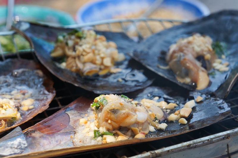 Close-up of seafood on metal grate